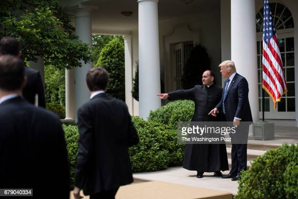 President Donald Trump greets others after signing an executive order aimed at easing an IRS rule limiting political activity for churches during a...