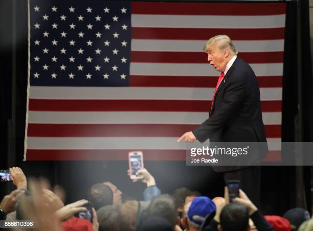 S President Donald Trump greets people during a rally at the Pensacola Bay Center on December 8 2017 in Pensacola Florida Mr Trump gave a further...