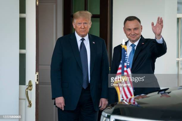 President Donald Trump greets Polish President Andrzej Duda as he arrives at the West Wing of the White House on June 24, 2020 in Washington, DC. The...