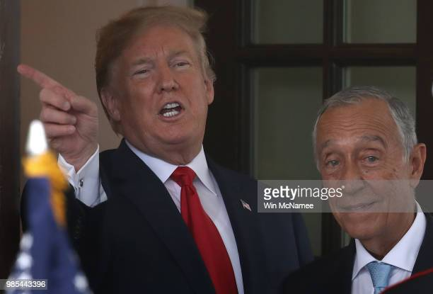 S President Donald Trump greets Portuguese President Marcelo Rebelo de Sousa at the White House June 27 2018 in Washington DC The two leaders were...