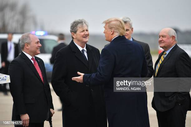 US President Donald Trump greets Rep Steve Scalise RLA Sen John Kennedy RLA and Secretary of Agriculture Sonny Perdueupon arrival at Louis Armstrong...