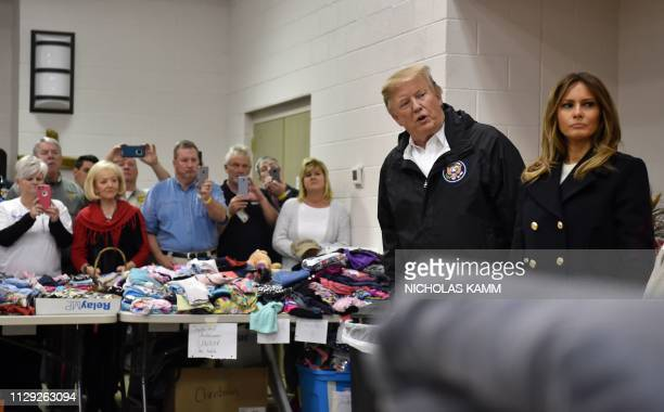 US President Donald Trump greets residents March 8 2019 in Opelika Alabama during a tour of tornadodamaged areas in the southern US state