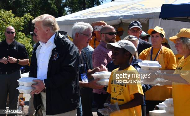 US President Donald Trump greets residents on September 19 2018 at Temple Baptist Church in New Bern North Carolina as he tours areas of the eastern...