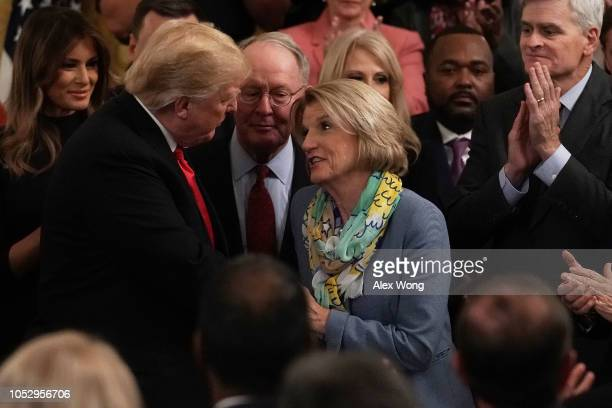 S President Donald Trump greets Sen Shelley Moore Capito during an East Room event at the White House October 24 2018 in Washington DC President...