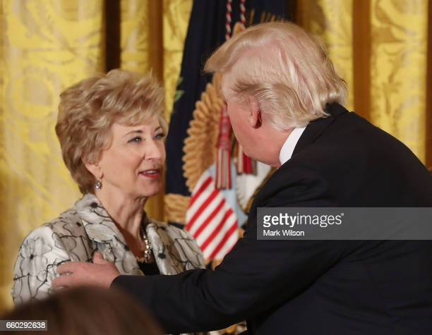 S President Donald Trump greets Small Business Administration head Linda McMahon during an event celebrating Women's History Month in the East Room...