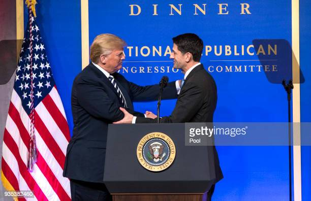 President Donald Trump greets Speaker of the House Paul Ryan RWI as he arrives on stage to delivers remarks at the National Republican Congressional...