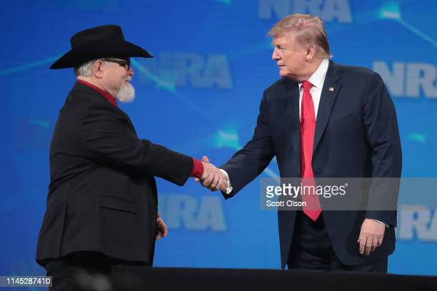 President Donald Trump greets Stephen Willeford who confronted and shot the gunman during a mass shooting at a church in Sutherland Springs Texas at...