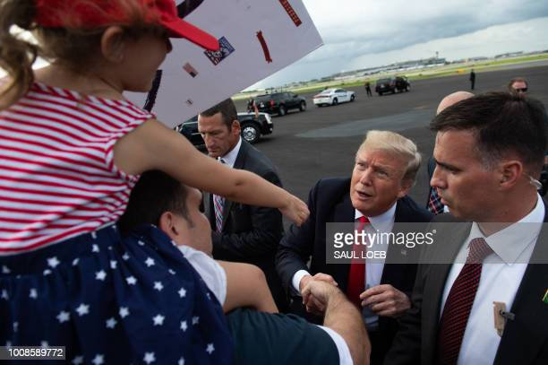 US President Donald Trump greets supporters after arriving on Air Force One at Tampa International Airport in Tampa Florida July 31 2018
