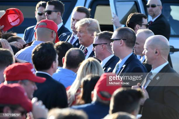 S President Donald Trump greets supporters after arriving on Air Force One at LAX Airport on February 18 2020 in Los Angeles California
