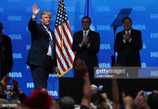 S President Donald Trump greets supporters as Executive Director NRAILA Chris Cox and NRA Executive Vice President Wayne LaPierre look on at the...