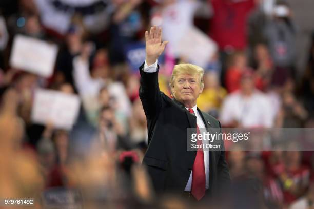 President Donald Trump greets supporters as he arrives for a campaign rally at the Amsoil Arena on June 20 2018 in Duluth Minnesota Earlier today...