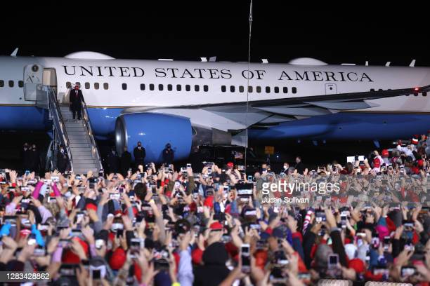 President Donald Trump greets supporters as he walks off of Air Force One during a campaign rally at Richard B. Russell Airport on November 01, 2020...