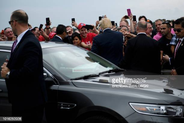 US President Donald Trump greets supporters at Griffiss International Airport August 13 2018 in Rome New York