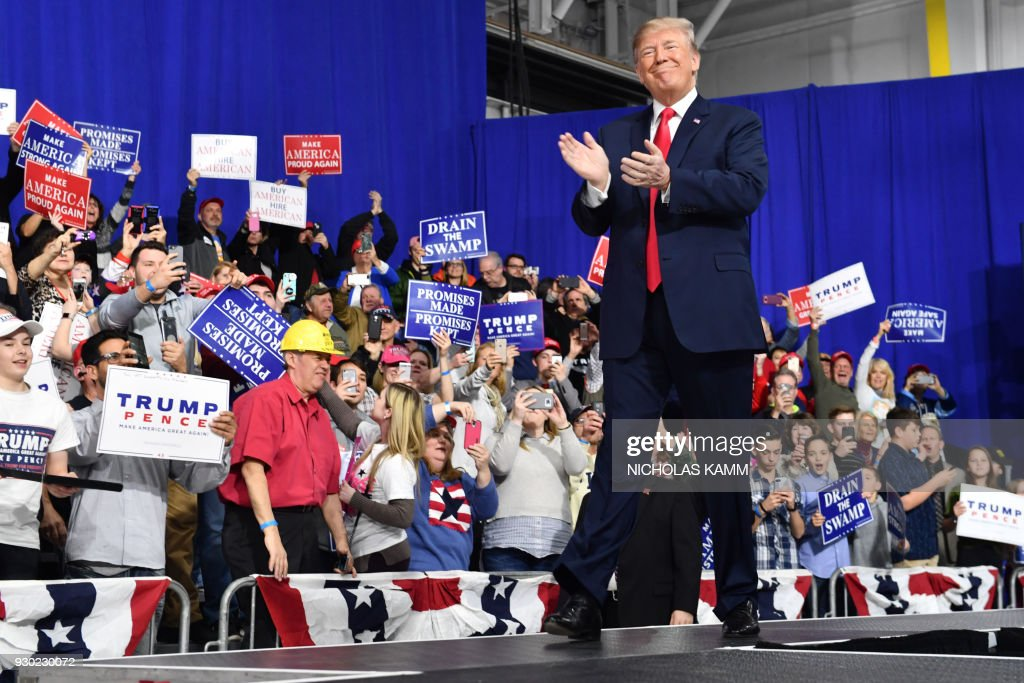 President Donald Trump greets supporters at the Make America Great Again Rally on March 10, 2018 in Moon Township, Pennsylvania. President Trump travelled to Pennsylvania to speak at a ' Make America Great Again ' rally on behalf of Republican candidate Rick Saccone. / AFP PHOTO / Nicholas Kamm