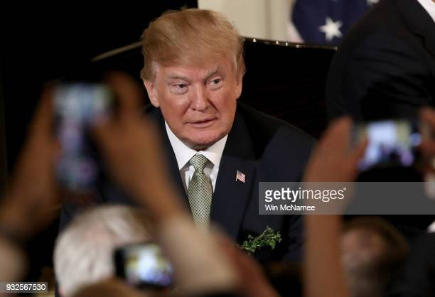 S President Donald Trump greets supporters at the White House following an event with Irish Prime Minister Leo Varadkar March 15 2018 in Washington...