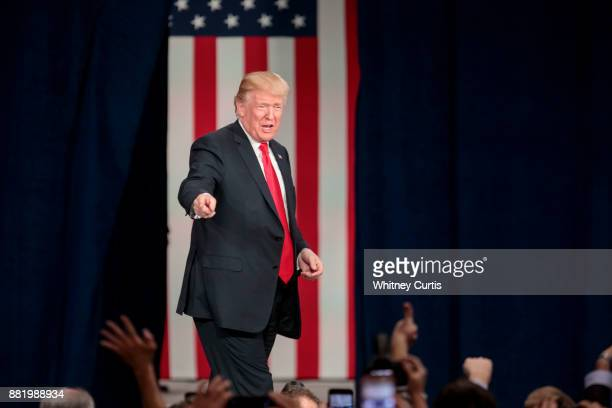 S President Donald Trump greets supporters before his speech on tax reform at the St Charles Convention Center on November 29 2017 in St Charles...