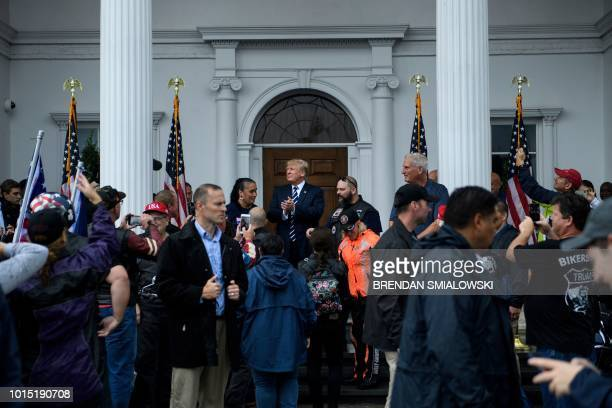US President Donald Trump greets supporters during a Bikers for Trump event at the Trump National Golf Club August 11 2018 in Bedminster New Jersey...