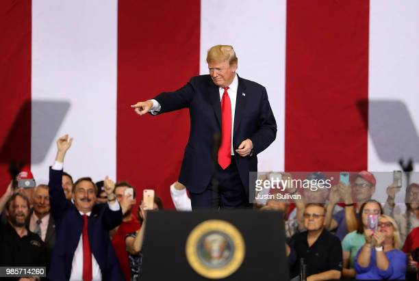 S president Donald Trump greets supporters during a campaign rally at Scheels Arena on June 27 2018 in Fargo North Dakota President Trump held a...