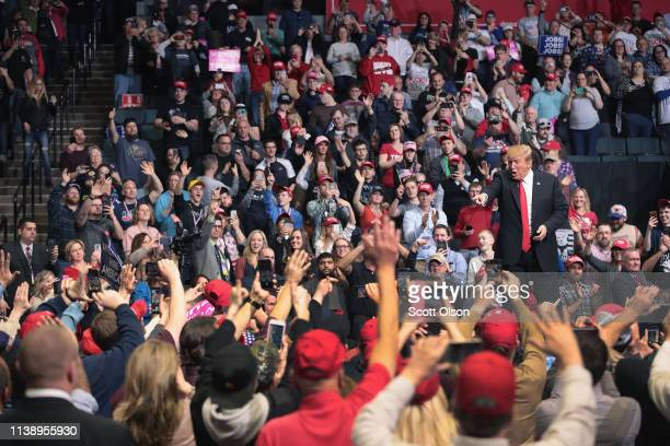 President Donald Trump greets supporters during a rally at the Van Andel Arena on March 28, 2019 in Grand Rapids, Michigan. Grand Rapids was the...