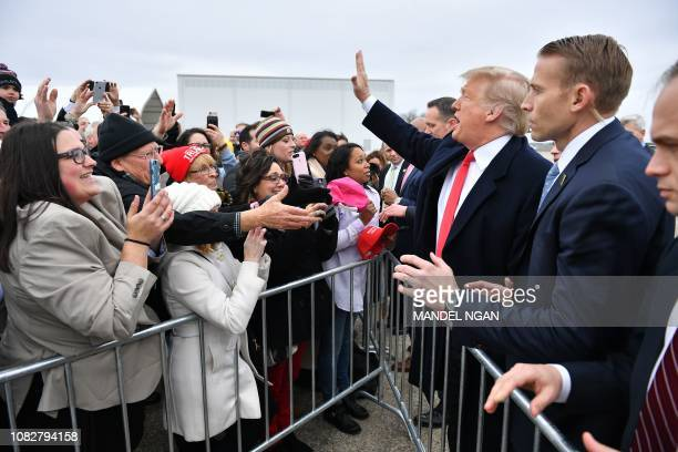 US President Donald Trump greets supporters upon arrival at Louis Armstrong New Orleans International Airport in Kenner Louisiana on January 14 2019