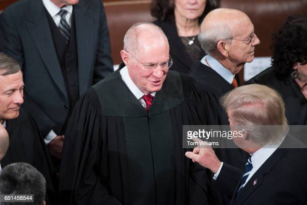 President Donald Trump greets Supreme Court Justice Anthony Kennedy after addressing a joint session of Congress in the Capitol's House Chamber...