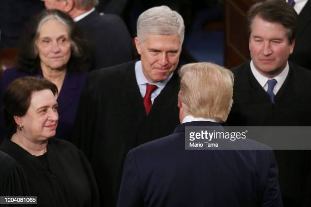 President Donald Trump greets Supreme Court Justice Neil Gorsuch ahead of the State of the Union address in the chamber of the U.S. House of...