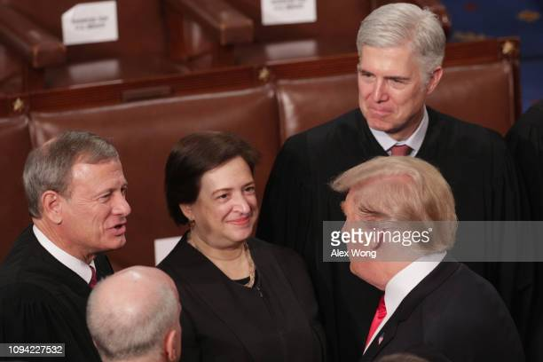 President Donald Trump greets Supreme Court Justices John Roberts, Elena Kagan, and Neil Gorsuch after the State of the Union address in the chamber...