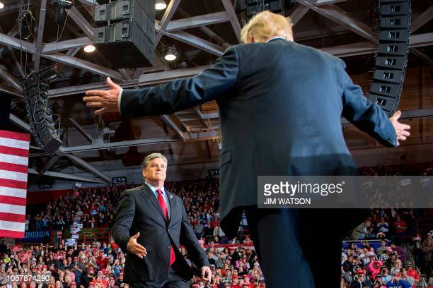 President Donald Trump greets talk show host Sean Hannity at a Make America Great Again rally in Cape Girardeau Missouri on November 5 2018