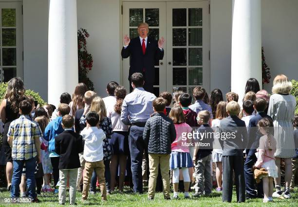 President Donald Trump greets the children of members of the media and White House staff during Take Your Child To Work Day in the Rose Garden at the...