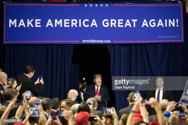 President Donald Trump greets the crowd during a campaign rally at Freedom Hall on October 1 2018 in Johnson City Tennessee President Trump held the...