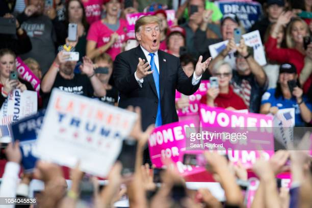 S President Donald Trump greets the crowd during a campaign rally at the Bojangles Coliseum on October 26 2018 in Charlotte North Carolina President...