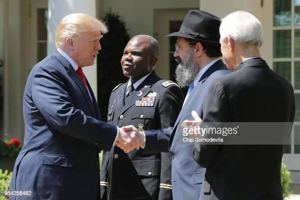 US President Donald Trump greets US Army Chaplain Corps Lieutenant Colonel Dawud AbdulAziz Agbere Rabbi Levi Shemtov of the Rabbinical Council of...