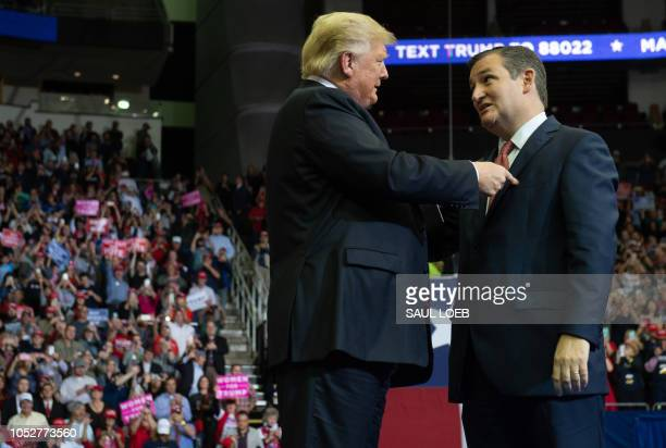 US President Donald Trump greets US Senator Ted Cruz Republican of Texas during a campaign rally at the Toyota Center in Houston Texas October 22 2018