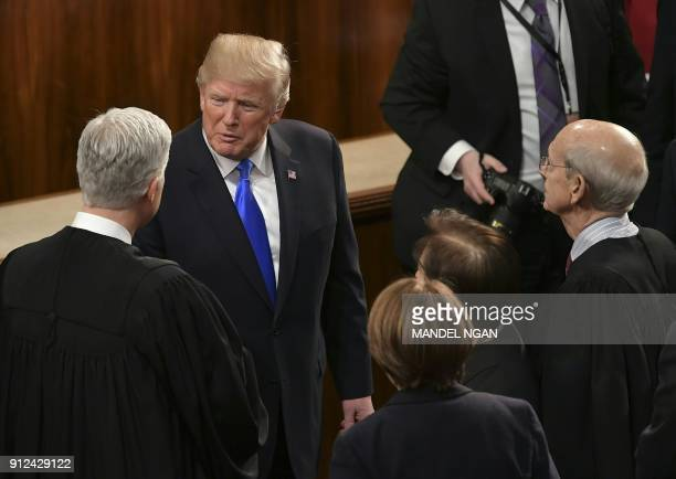 US President Donald Trump greets US Supreme Court justices Neil Gorsuch Sonia Sotomayor and Stephen Breyer following his State of the Union address...