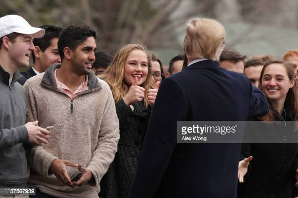 S President Donald Trump greets visitors prior to his departure from the White House March 22 2019 in Washington DC President Trump is traveling to...