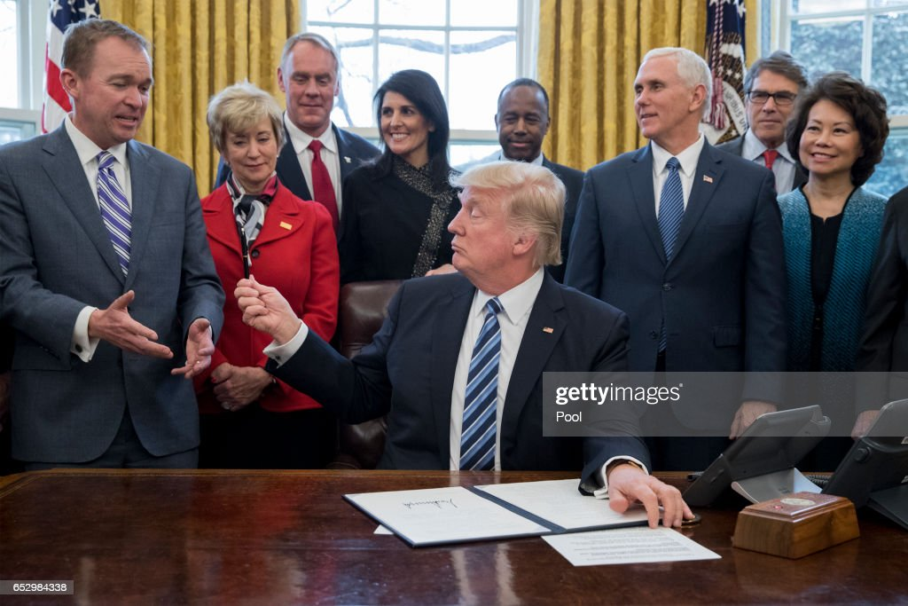 President Trump Signs Executive Order In Oval Office : News Photo