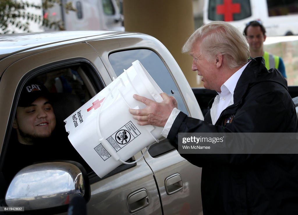 U.S. President Donald Trump hands out emergency supplies to residents impacted by Hurricane Harvey while visiting the First Church of Pearland September 2, 2017 in Pearland, Texas. Pearland, just south of Houston, was heavily damaged by the floodwaters created by the hurricane.