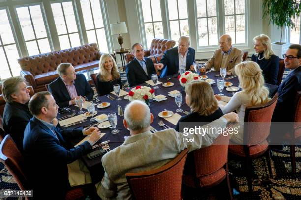 President Donald Trump has a working lunch with staff and cabinet members and significant others at his golf course Trump National on March 11 2017...