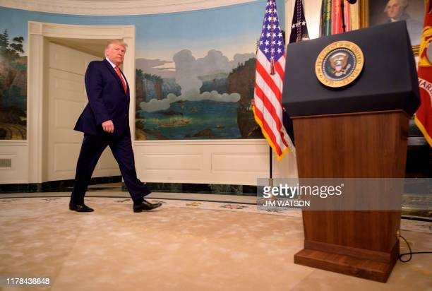 US President Donald Trump heads to the lectern to make a major announcement October 27 2019 the White House in Washington DC Trump confirmed the...