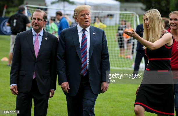 President Donald Trump Health And Human Services Secretary Alex Azar and Ivanka Trump walk as they watch young participants during the White House...