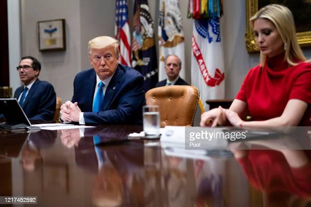 S President Donald Trump his daughter senior advisor to the President Ivanka Trump and Treasury Secretary Steven Mnuchin participate in a video...