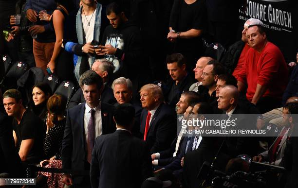 US President Donald Trump his son Eric Trump and House Minority Leader Kevin McCarthy watch the Ultimate Fighting Championship at Madison Square...