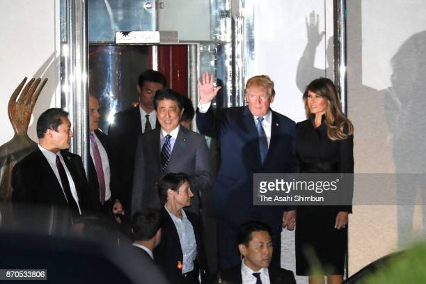 US President Donald Trump his wife Melania and Japanese Prime Minister Shinzo Abe leave after their dinner at Ukaitei restaurant on November 5 2017...