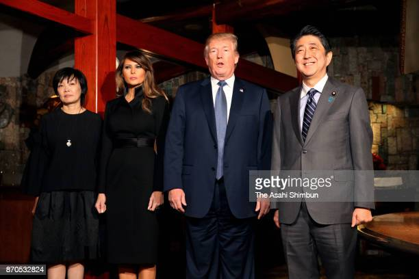 US President Donald Trump his wife Melania Japanese Prime Minister Shinzo Abe and his wife Akie pose for photographs prior to their dinner at Ukaitei...