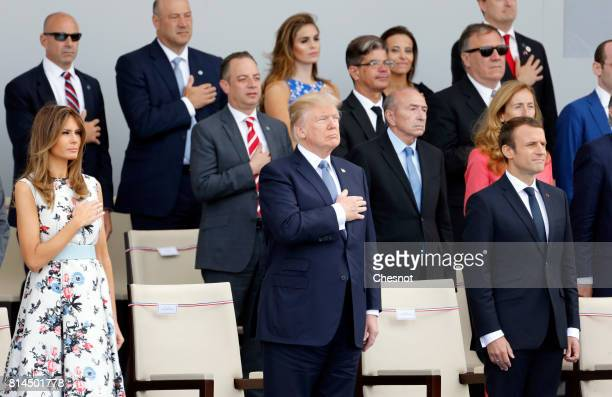 President Donald Trump, his wife Melania Trump and French President Emmanuel Macron attend the traditional Bastille day military parade on the...