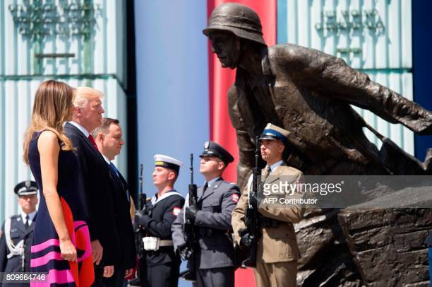 US President Donald Trump his wife Melania Trump and Polish President Andrzej Duda stand in front of the Warsaw Uprising Monument on Krasinski Square...
