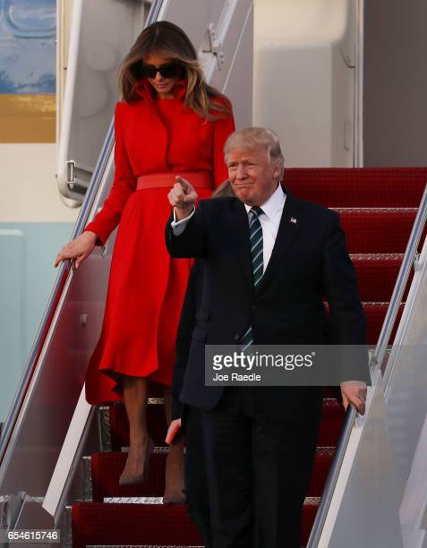 President Donald Trump his wife Melania Trump arrive together on Air Force One at the Palm Beach International Airport to spend part of the weekend...