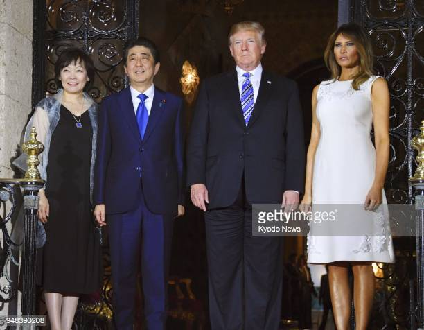 US President Donald Trump his wife Melania Trump Japanese Prime Minister Shinzo Abe and his wife Akie Abe pose for photos ahead of a dinner reception...