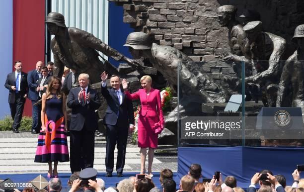 US President Donald Trump his wife Melania Trump Polish President Andrzej Duda and his wife Agata KornhauserDuda attend a wreath laying ceremony in...