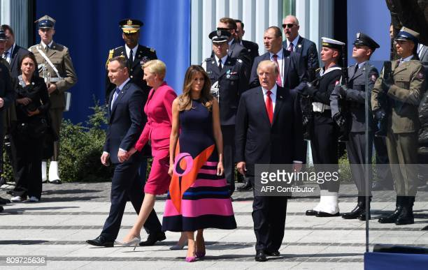 President Donald Trump , his wife Melania Trump , Polish President Andrzej Duda and his wife Agata Kornhauser-Duda attend a wreath laying ceremony in...